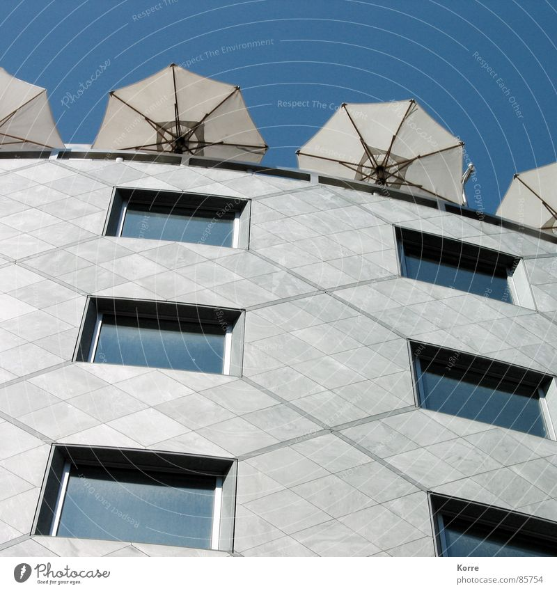 Summer on the roof Colour photo Exterior shot Deserted Day Worm's-eye view Sky Vienna Austria Europe High-rise Facade Window Modern Town Sunshade Roof terrace