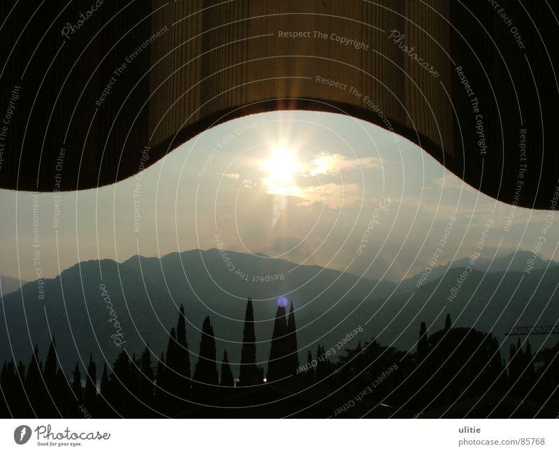 Sky Sun Summer Black Mountain Gray Glittering Round Point Dusk Evening sun Sun blind Canopy Stone pine Lake Garda