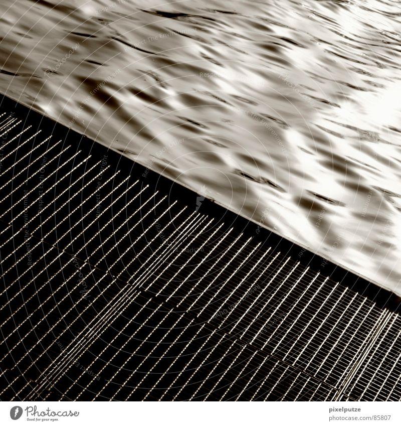 Drain. Flash Meticulous Neckar Go under Crash Waves Fluid Wet Damp Footbridge Square Gray Black Harmonious Drop anchor Stuttgart Drainage Brook Electricity