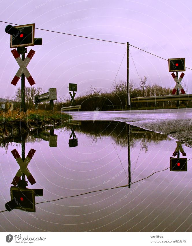 Rain Signs and labeling Railroad Railroad tracks Station Train station Barrier Traffic light Puddle Double exposure Symmetry Intersection Crash barrier Warning light Railroad crossing Roadblock