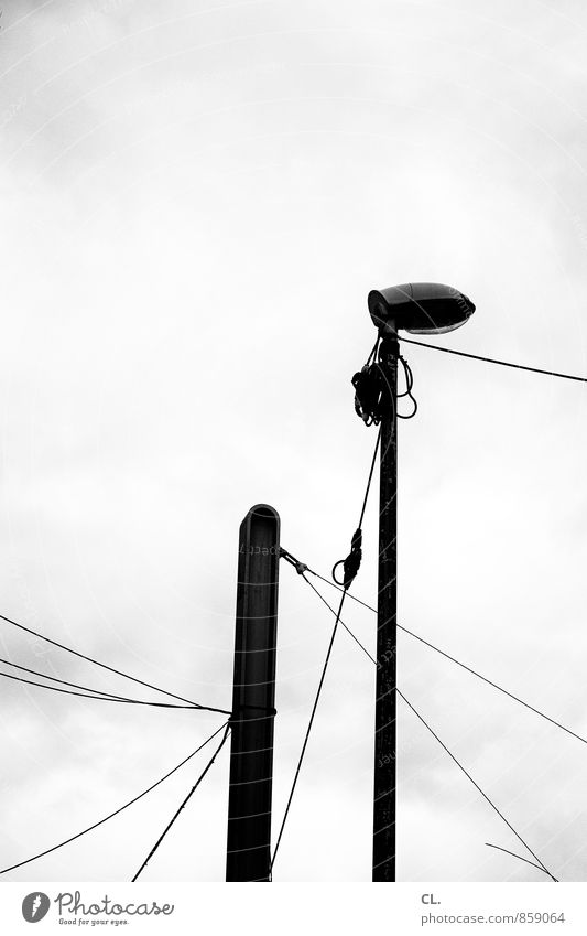 lantern, lines Sky Clouds Bad weather Street lighting Lamp post Cable Electricity Gloomy Town Boredom Line Black & white photo Exterior shot Deserted