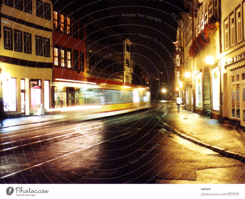city impressions Tram Night Light Impression Long exposure Vanishing point House (Residential Structure) Lantern Traffic infrastructure Street Colour