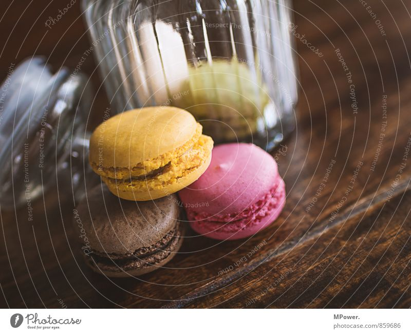 macarons Food Dessert Candy Chocolate Nutrition Eating To have a coffee Fast food Finger food Juicy Brown Yellow Pink Cookie Cookie tin Delicious Wooden table