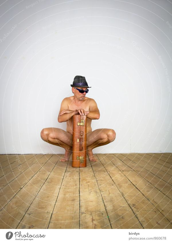Naked man with sunglasses, hat and an old suitcase in a funny pose Man Adults 1 Human being 45 - 60 years Wooden floor Suitcase Sunglasses Hat Observe Crouch