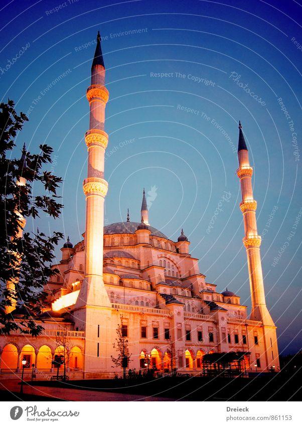 oblique luminous Architecture adana Turkey Asia Town Downtown Park Tower Manmade structures Building Mosque Minaret Tourist Attraction Large Blue Yellow Gold
