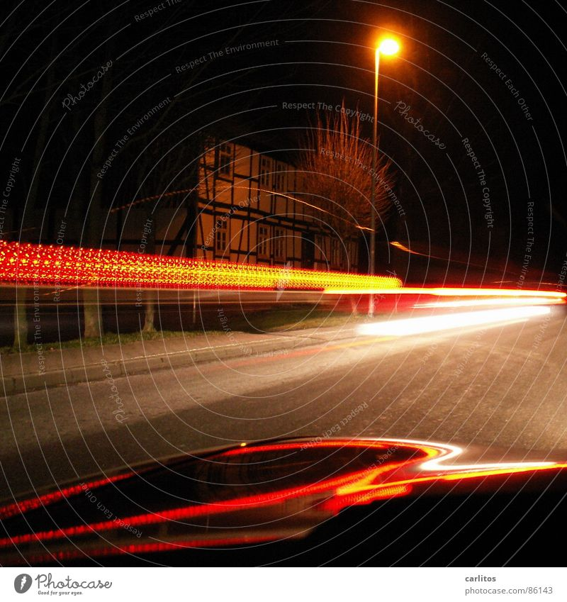 Mr. Beam Night Light Tracer path Rear light Street lighting Long exposure Driving Car Hood Half-timbered facade Half-timbered house Road traffic Country road