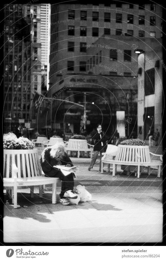 Homeless Rockefeller Center Plaza New York City Tramp Facial hair Newspaper Poverty Financial difficulty Pathetic To enjoy Beg Amusement Park Man poor Bench
