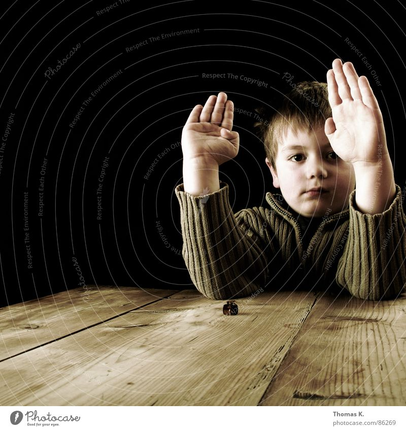 Hand signals. Light Dark Black Minimal Junior Think Boy (child) Shaft of light Bright Table Gesture Signal Wood Palm of the hand Stop Stripe Self-made