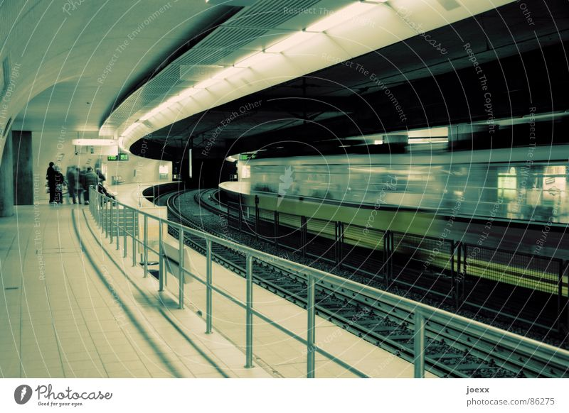 Human being Group Sadness Lighting Wait Railroad Speed Driving Stand Stop Railroad tracks Station Underground Train station Handrail Blanket