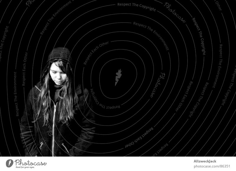 Black is Black Marginal group Woman Exterior shot Black-haired Freckles Portrait photograph Hooded (clothing) Anorak Long-haired Loneliness Grief Exit route