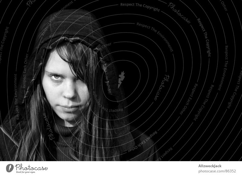Black is Black 2 Woman Exterior shot Black-haired Freckles Portrait photograph Hooded (clothing) Anorak Long-haired Loneliness Grief Exit route Marginal group