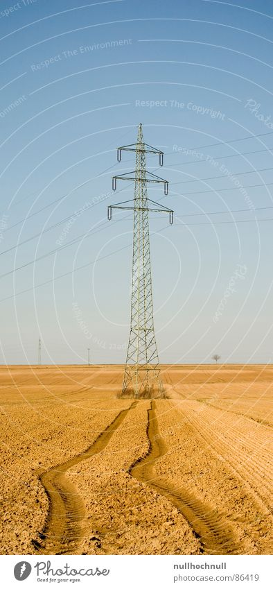 Power pole on the run Arable land Electricity Cable Field Skid marks High voltage power line Tractor track Industry Transmission lines Tracks Beautiful weather