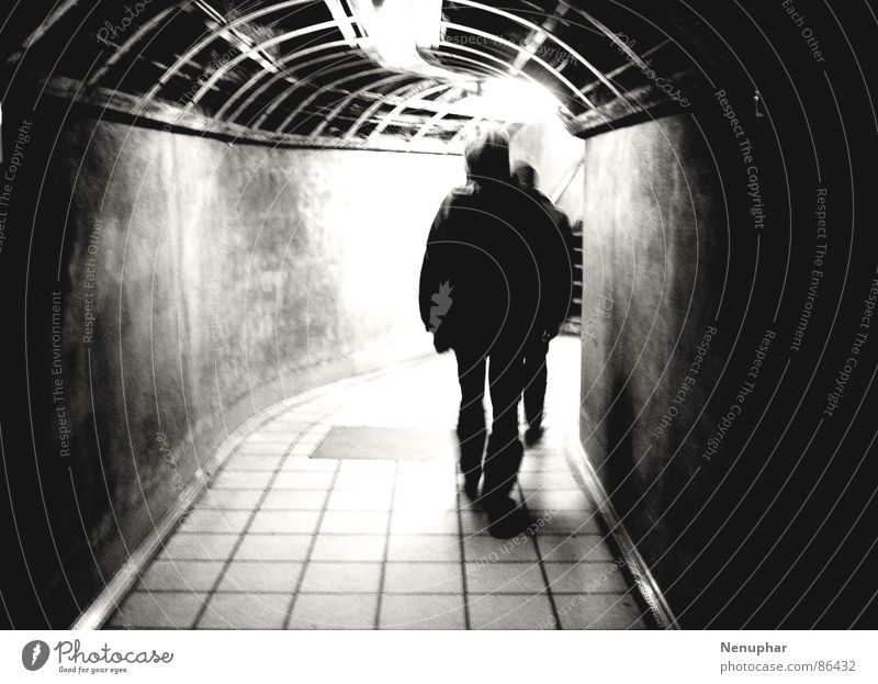 leaving Tunnel Subsoil Downward Dark Entrance Underground Surprise Expectation Pedestrian underpass Pursue Derelict Black & white photo at the end of the tunnel