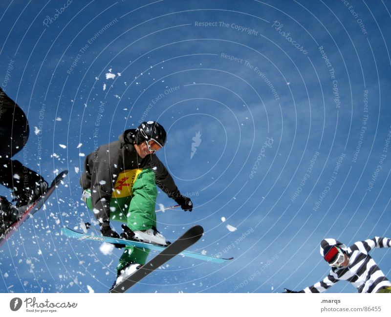Three jump Colour photo Exterior shot Copy Space top Day Snow Mountain Sports Winter sports Sporting event Skis Snowboard 3 Human being Boots Movement Jump