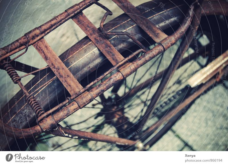 design grate Bicycle Metal Retro Brown Rust luggage carrier Street Old Exterior shot Deserted Day Shallow depth of field