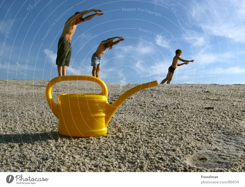 can acrobatics Jug Watering can Yellow Summer Physics Aperture Art Arts and crafts  Mining Sun Warmth Swimming & Bathing Perspective Sky Surrealism Irritation