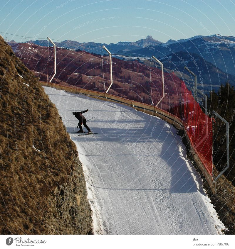 Deep snow? Slope Grass Skier Stick Morning Beautiful Winter sports Doomed snowway Snow Ski run Lanes & trails too warm Net Catching net Protection Vantage point