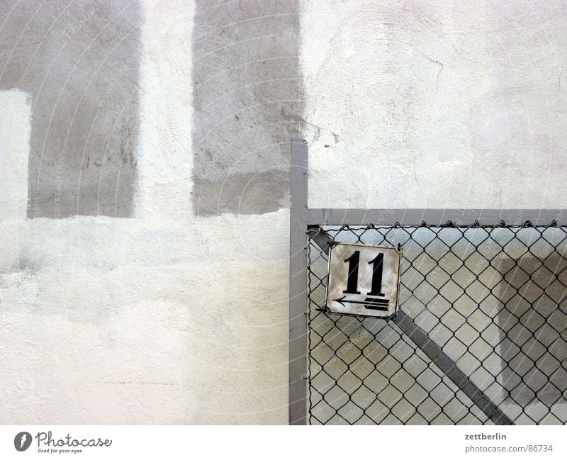 elf Numbers Penalty kick Digits and numbers House number Entrance Way out Wall (barrier) Paintwork Absurdity Line Wire netting fence Gable end Gate Passage