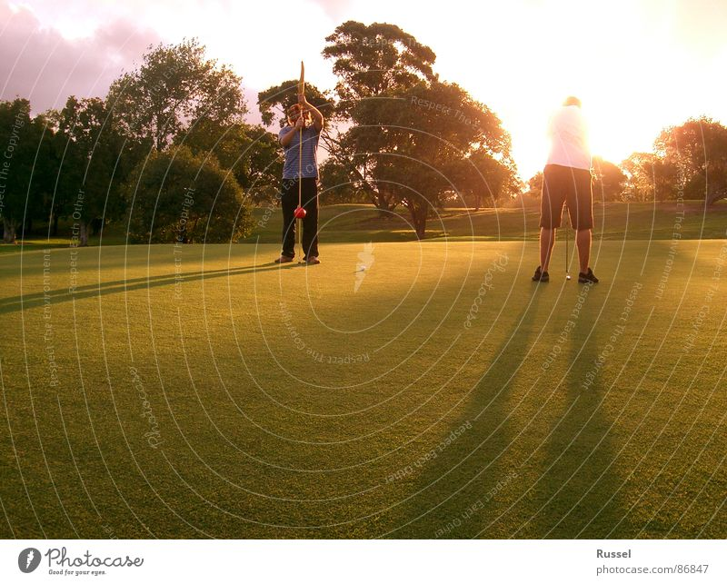 The last hole Dusk Sunset Green 2 Closing time Friendship Golf course Man Masculine Physics Grass Evening Places Sports Playing Youth (Young adults) Concentrate