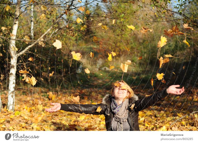 Young woman enjoying falling autumn leaves in park Human being Woman Nature Youth (Young adults) Beautiful Tree Hand Landscape Joy 18 - 30 years Forest Adults