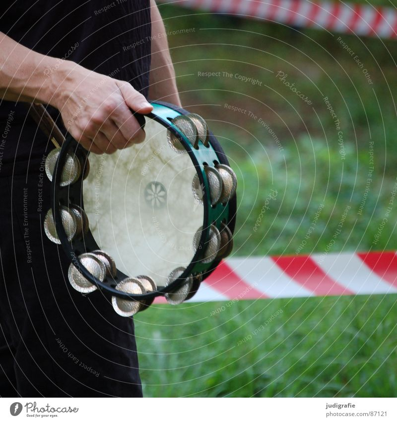 Outside the restricted zone Pandeiro Tambourine Exclusion zone Closed Striped Red Hand Sound Percussion instrument Concert Calm Grass Rhythm Musical instrument