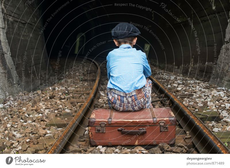 Child in vintage clothes sits on railway road Vacation & Travel Trip Human being Girl Boy (child) Infancy Nature Transport Railroad Suitcase To fall Sit Sadness
