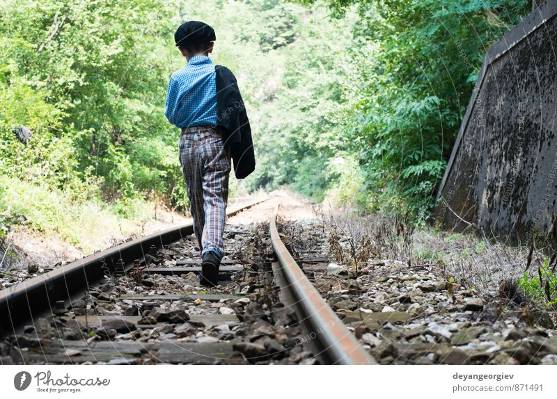 Child walking on railway Human being Nature Vacation & Travel Loneliness Boy (child) Small Infancy Cute Railroad Rural Caucasian