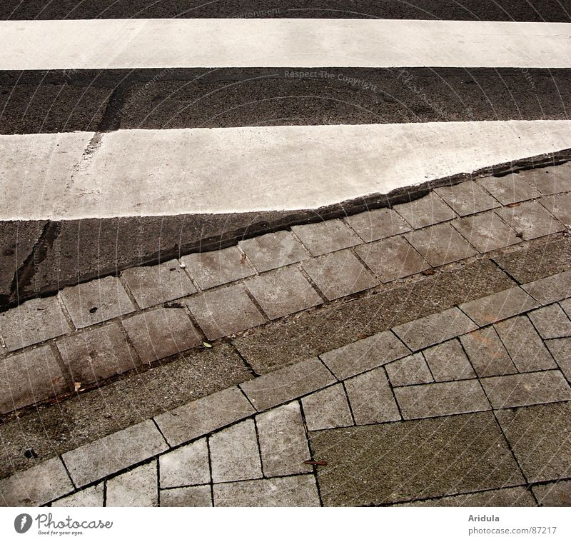 Street Gray Stone Lanes & trails Stripe Sidewalk Traffic infrastructure Pavement Minerals Traverse Zebra crossing
