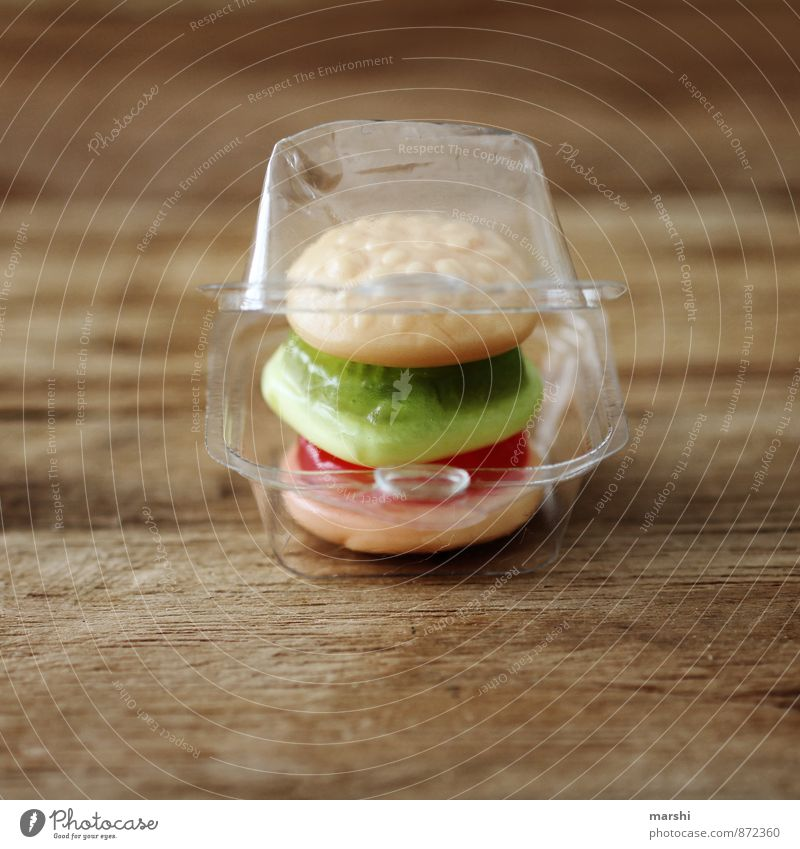 MiniSnack Food Lettuce Salad Candy Nutrition Eating Lunch Fast food Emotions Moody Hamburger Small Packaging Wooden board Meal Appetite Colour photo