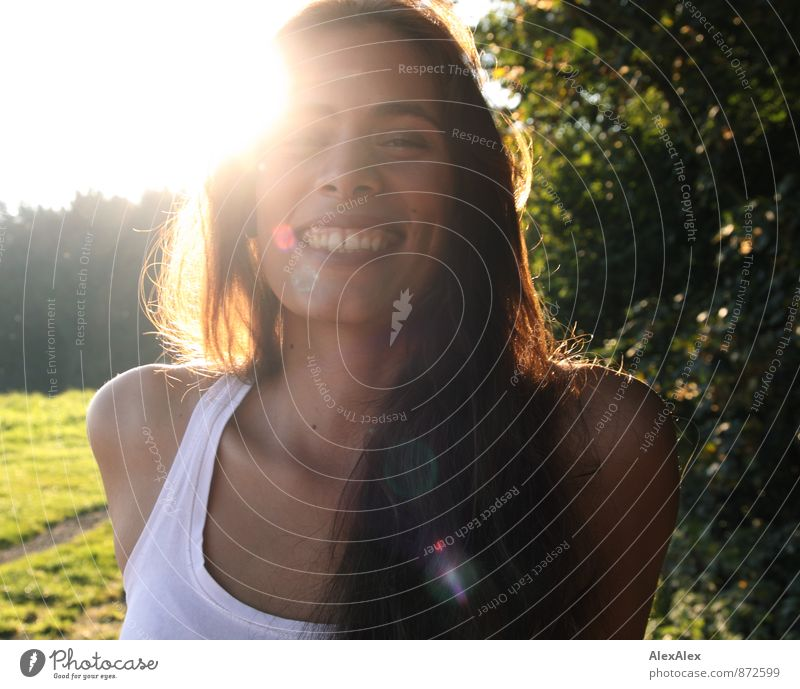 Young beautiful woman laughing with dimples backlit Trip Adventure Summer vacation Young woman Youth (Young adults) Face 18 - 30 years Adults Nature Sun