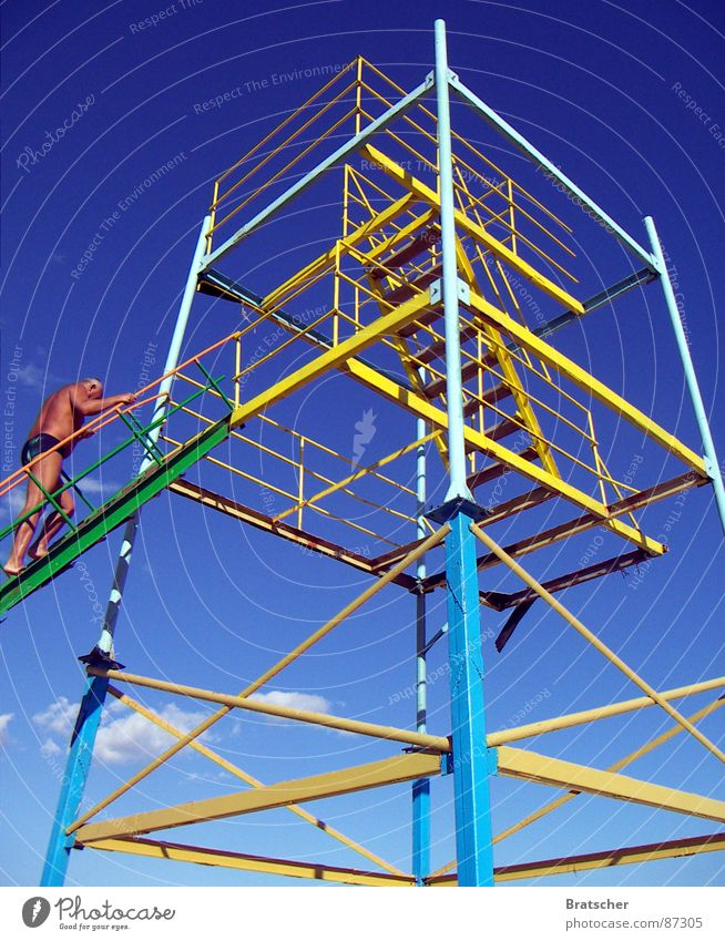 Clouds Senior citizen Tall Crazy Tower Derelict Handrail Concentrate Bizarre Sunbathing Swimming trunks Mafia Monstrous Illusion Pool attendant