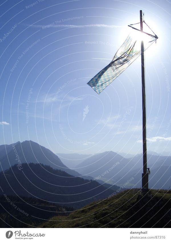 Sky Nature Blue Sun Far-off places Autumn Mountain Landscape Air Earth Wind Flag Alps Peak Pasture Beautiful weather