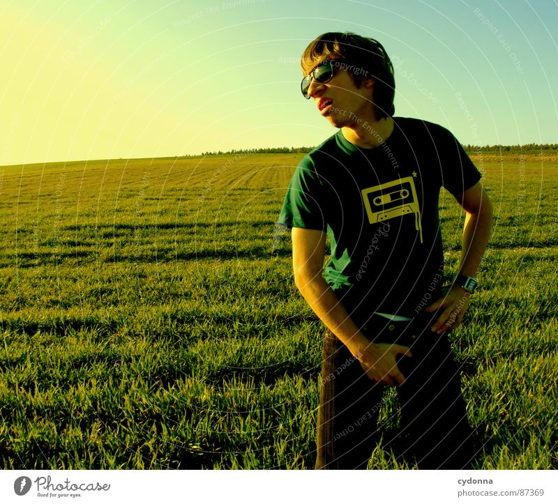 EI-CATCHER I Meadow Grass Green Style Sunset Posture Blade of grass Tape cassette Sunglasses Pornography Behavior Emotions Human being Joy Nature Landscape