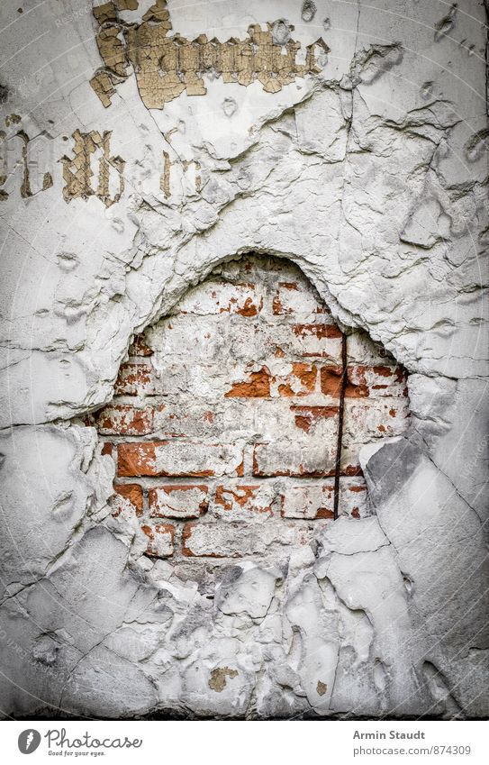 Fat bullet Wall (barrier) Wall (building) Facade Stone Gold Sign Characters Ornament Old Authentic Exceptional Threat Dirty Dark Broken Retro Red White