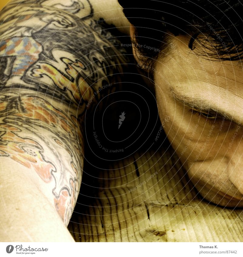 Day X. Portrait photograph Table Structures and shapes Wood Shoulder Biceps Upper arm Rustic Wood grain Stripe Tattoo Grief Distress Man Arm furnished with wood