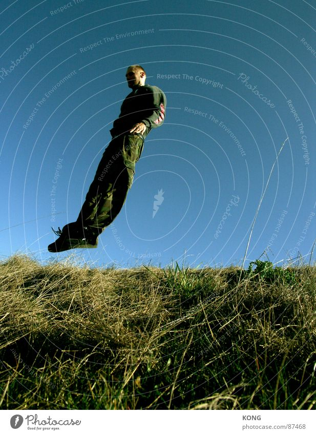 wind misalignment Supine position Jump Horizon Meadow Sky blue Diagonal Speed Green Hop Tilt Grass Joy Man Playing falling like a bird Flying flight fly
