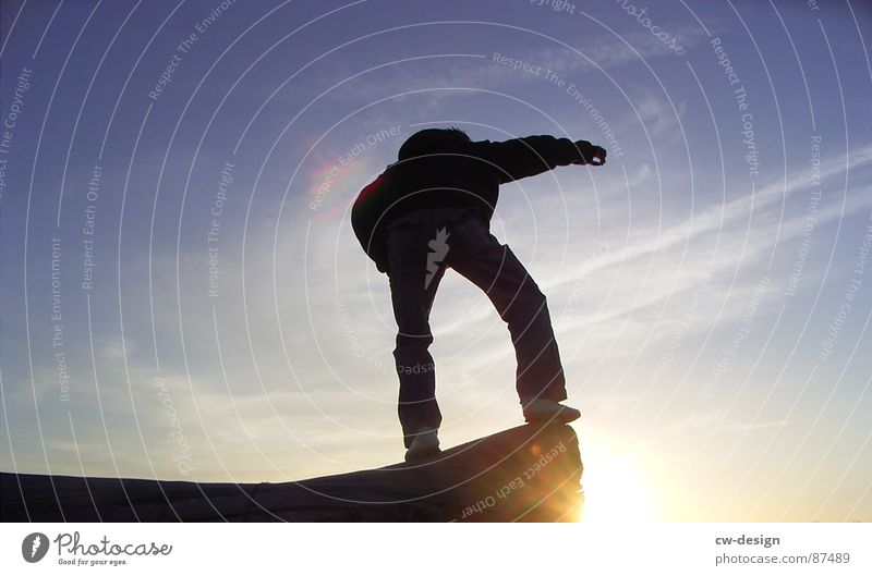 Human being Sky Black Landscape Sports Playing Grass Happy Keyword Field Masculine Success Empty Action New Stand