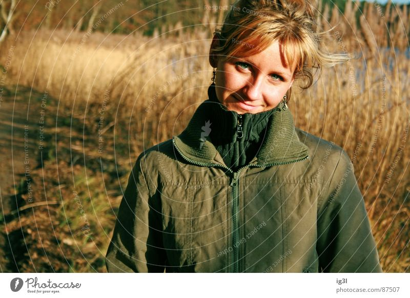 after 5 at the lake Lake Sun's position Woman Feminine Jacket Dusk Autumn Jump Spring fever Common Reed Grass Exterior shot Grinning Emotions Expectation Green