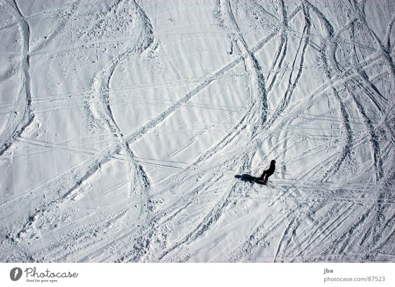no longer fresh Bird's-eye view Virgin snow Powder snow Power Skier Skiing Winter sports snow covered mist Snow Tracks Curve Line Shadow Wavy line