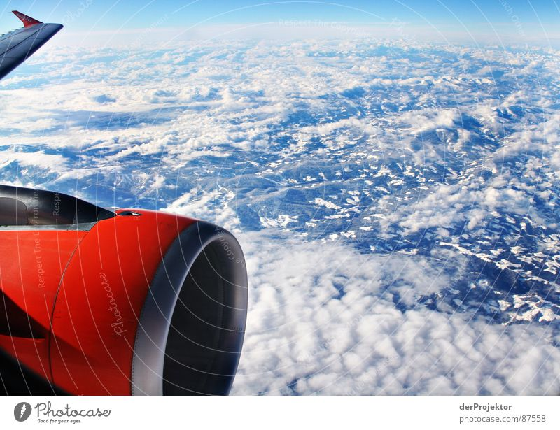 ORANGE-BLUE-WHITE Bla Airplane Wing Passenger plane Mountain ridge Whipped eggwhite Orange White Aircraft Mountain range Jet Globe Aviation sinkhole Sky Earth