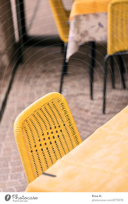 closing time Chair Table Wait Yellow Calm Tablecloth Restaurant Terrace Paving stone Closing time Colour photo Exterior shot Deserted Shallow depth of field
