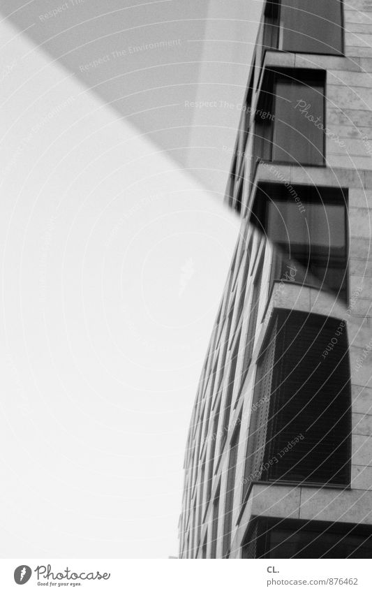 Buckling in the optics Sky Town High-rise Building Architecture Facade Window Glas facade Mirror Sharp-edged Gloomy Black & white photo Exterior shot Deserted