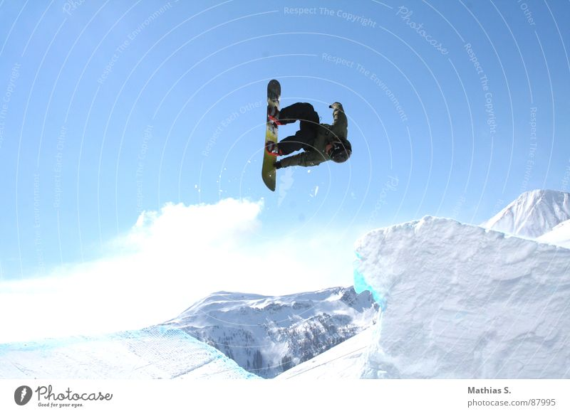 rodeo Rodeo Salto Jump Snowboard Austria Back somersault Clouds Austrian Style Exterior shot Winter sports Leisure and hobbies Freestyle Extreme Air Trick
