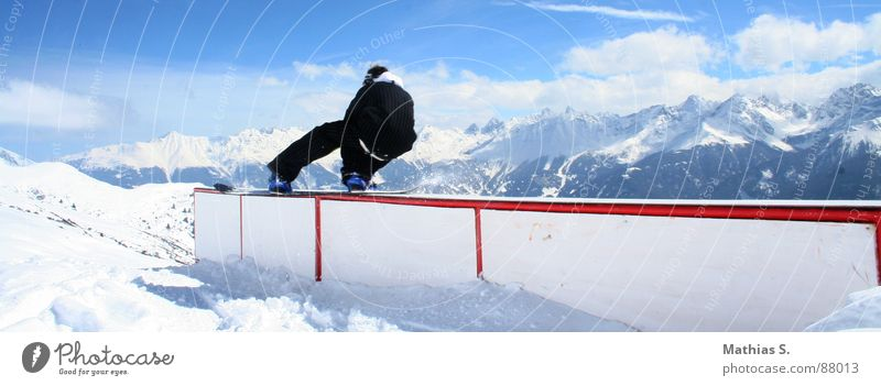 straight box Tailslide Snowboard Austria Clouds Austrian Style Exterior shot Winter sports Leisure and hobbies Freestyle Extreme Air Trick Resort Snowboarder