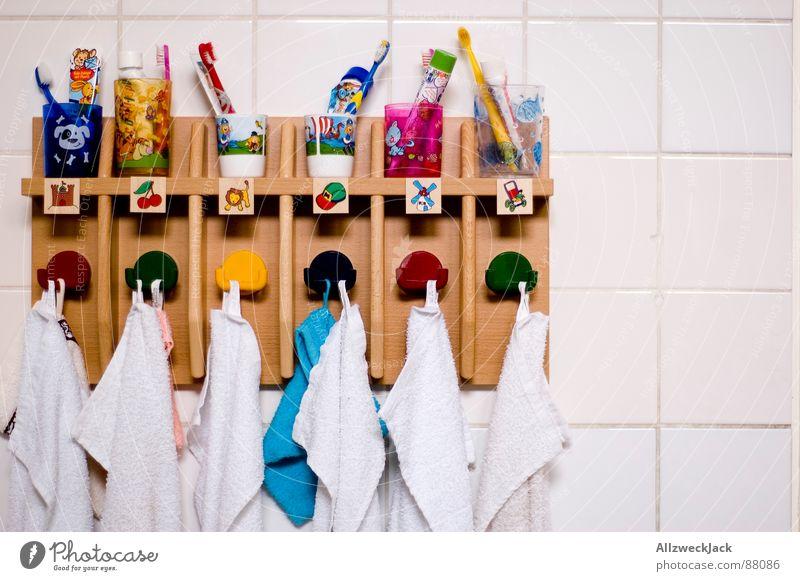 Order is half the life. Towel hook Toothpaste Toothbrush mug Kindergarten Preschool Education preschool education laundry room Tile Arrangement Infancy