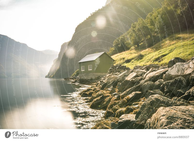 boathouse Forest Hill Rock Mountain Coast River bank Bay Fjord House (Residential Structure) Manmade structures Warmth Idyll Relaxation Nature Sun Sunbeam