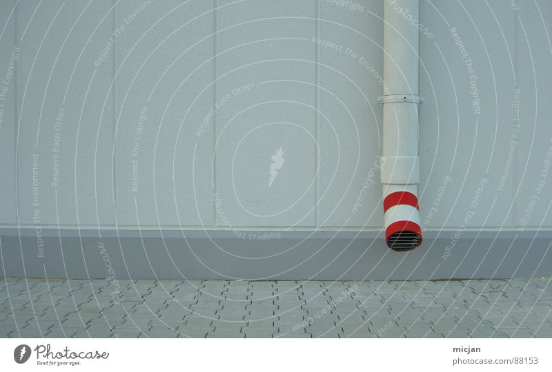 Tube with red on wall in grey Wall (building) Drainage Wall (barrier) Gray Red Stripe Circle Reddish white White Under Flow Grating Mucus Mud Water pipe