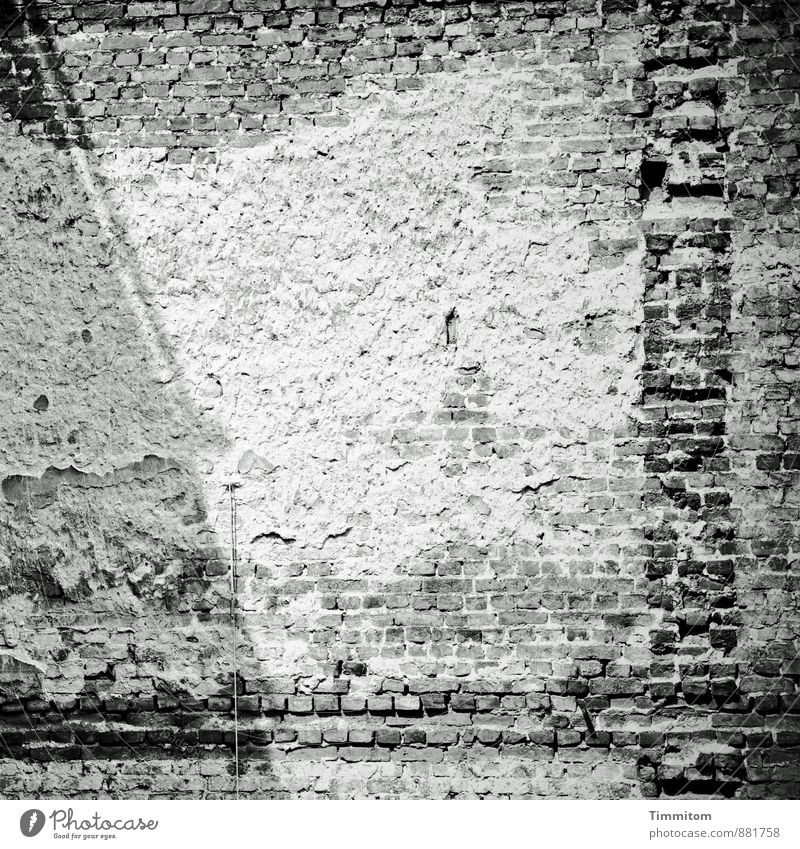 A picture of a wall. Deserted Manmade structures Architecture Wall (barrier) Wall (building) Interior courtyard Brick wall Plaster Transmission lines Shadow