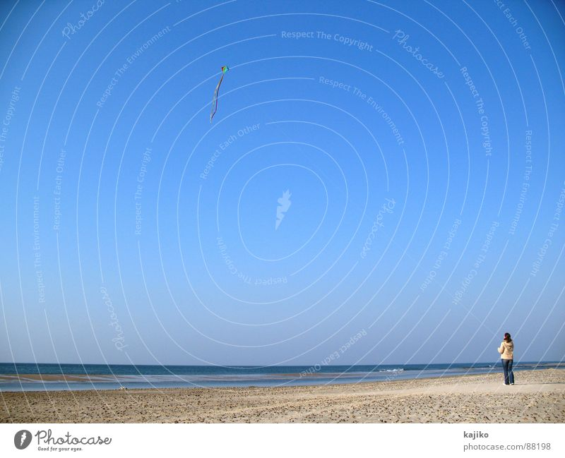 Woman Water Sky Ocean Blue Joy Beach Loneliness Autumn Freedom Sand Coast Flying Free Leisure and hobbies Beautiful weather