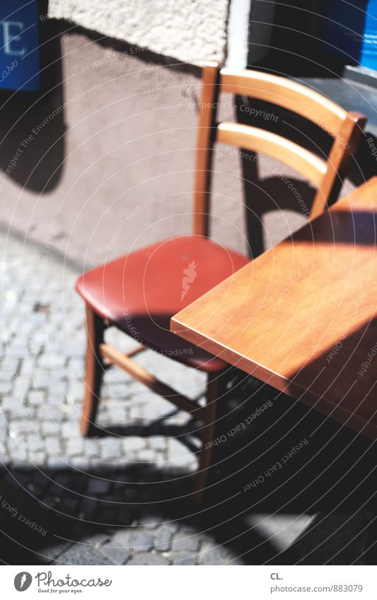 seating Wall (barrier) Wall (building) Chair Table Tabletop Cobblestones Sit 1 Colour photo Exterior shot Deserted Day Light Shadow Contrast